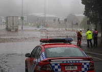 Emergency Responders Discuss Options for Rescuing a Woman Trapped on the Roof of Her Car in Flood Waters During the 2010-2011 Queensland Floods in Australia. Emergency Responders Discuss Options for Rescuing a Woman Trapped on the Roof of Her Car in Flood Waters During the 2010-2011 Queensland Floods in Australia. (Credit: Timothy Swinson/Flickr) Click to Enlarge.