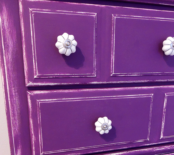 white knobs on purple dresser