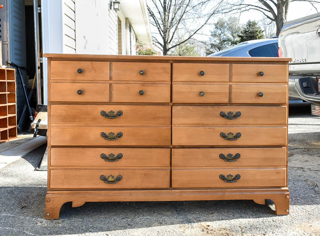 Dated wood dresser before