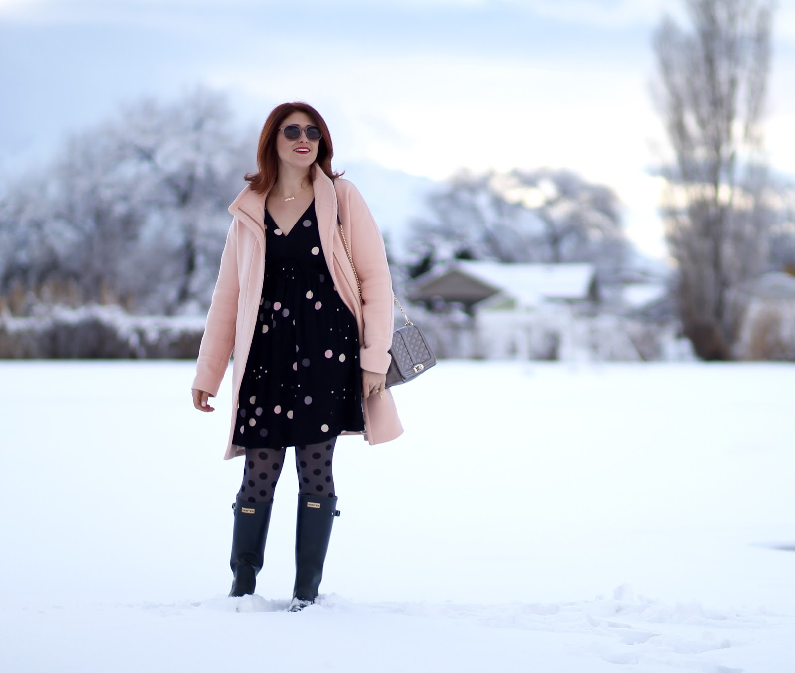 anthropologie felicity dress, polka dot tights, rebecca minkoff love crossbody, cocoon coat in pale ginger, red hair and navy hunter boots make a casual and cute affordable outfit for work or teacher
