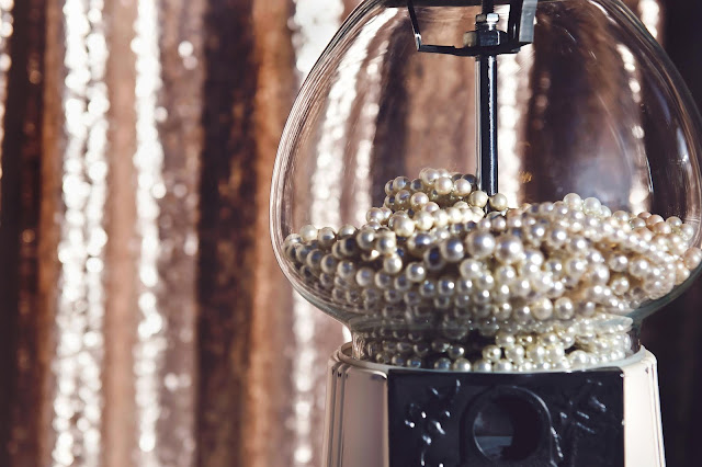 Pearls inside a gumball machine.