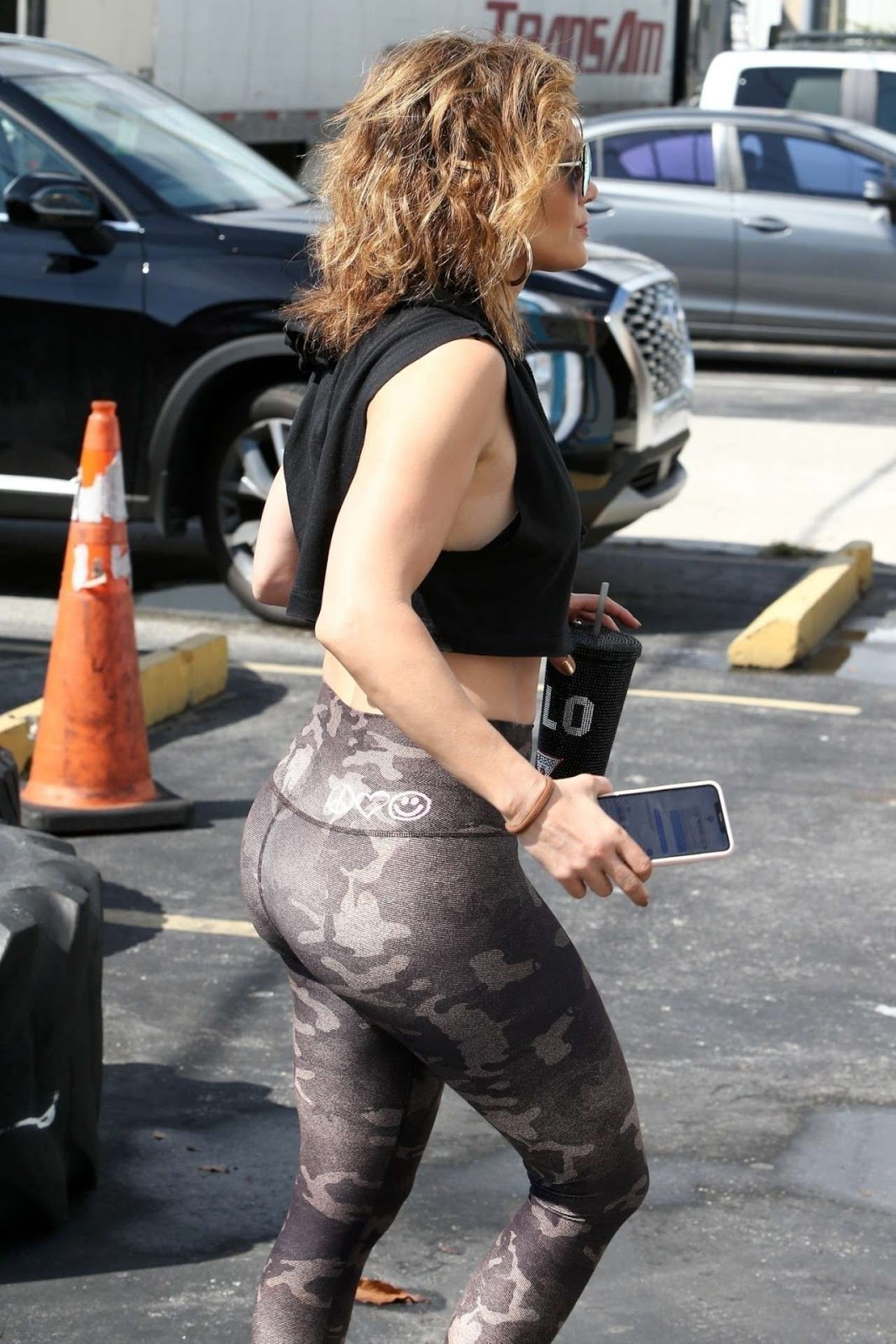 Jennifer Lopez showcases natural locks and pert bottom out and about in Miami