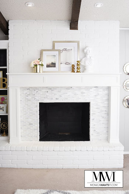 bright white fireplace with marble