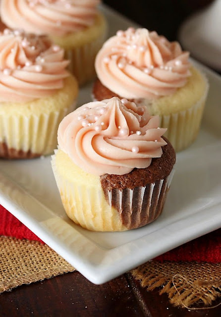 Neapolitan Cupcakes with Strawberry Frosting Image