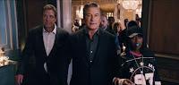 Dan Marino, Alec Baldwin and Missy Elliott walk through a house party