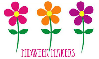 three brightly colored flower graphics
