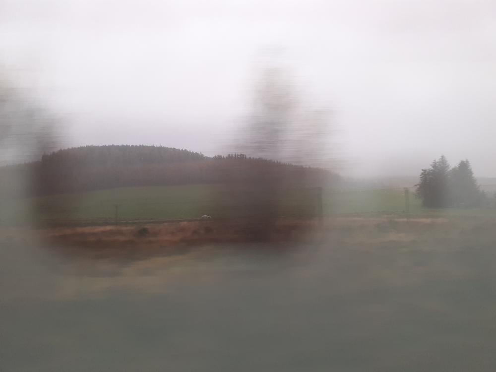 Scotland from a train window on a rainy day