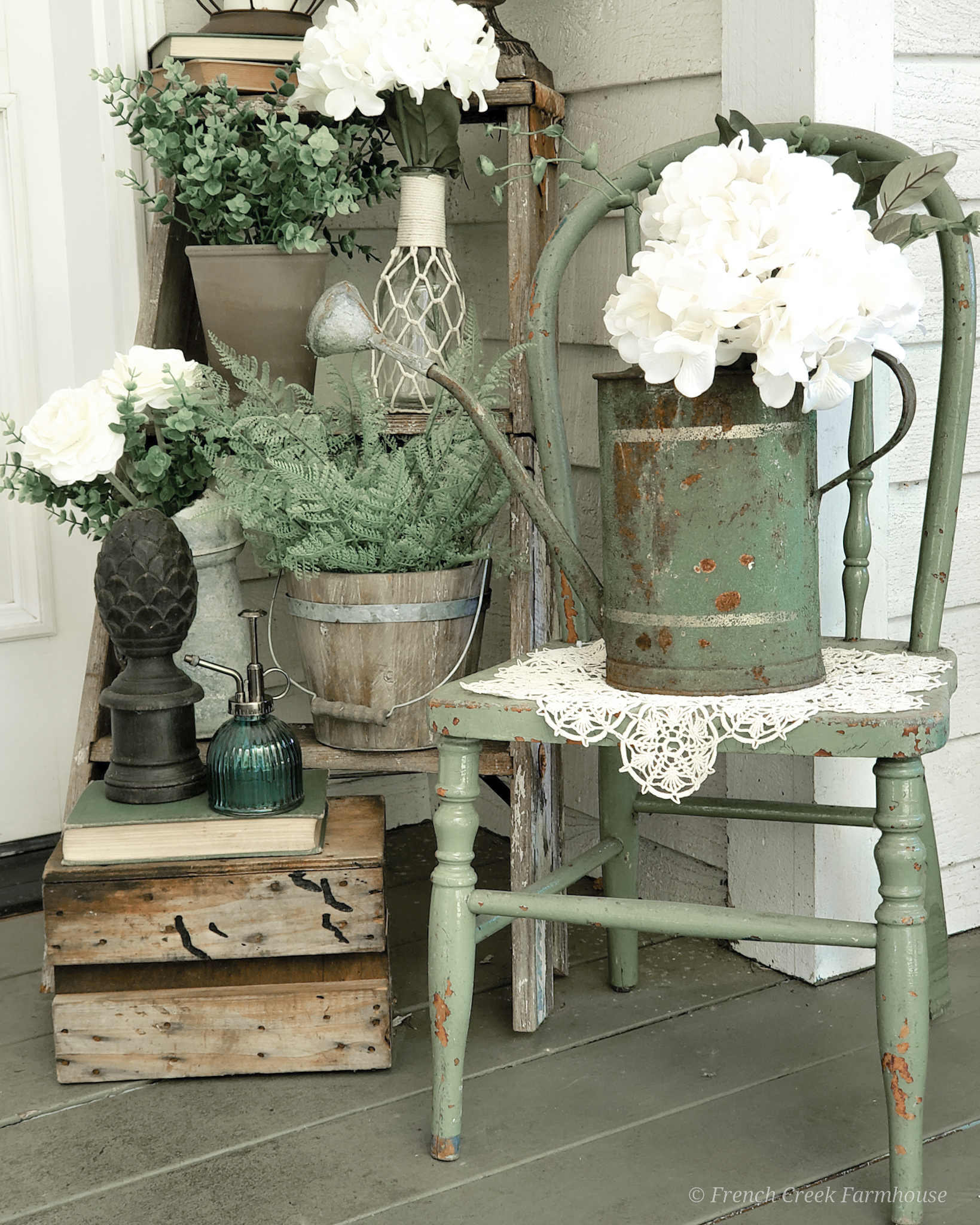 I'm using lots of spring blooms and vintage touches to decorate our porch this season
