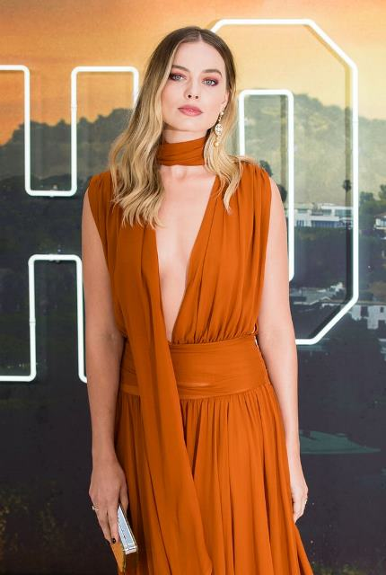 Margot's burnt-orange gown, from the Fall/Winter 2019 collection