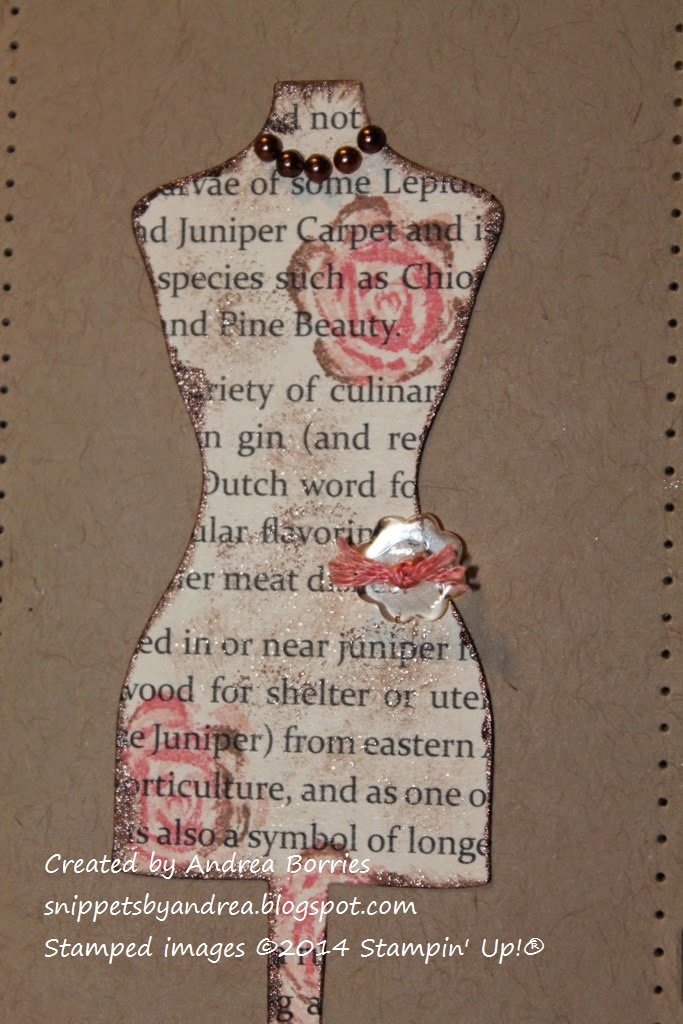 Close-up photo showing dress form die cut from newsprint-style paper and stamped with flowers.