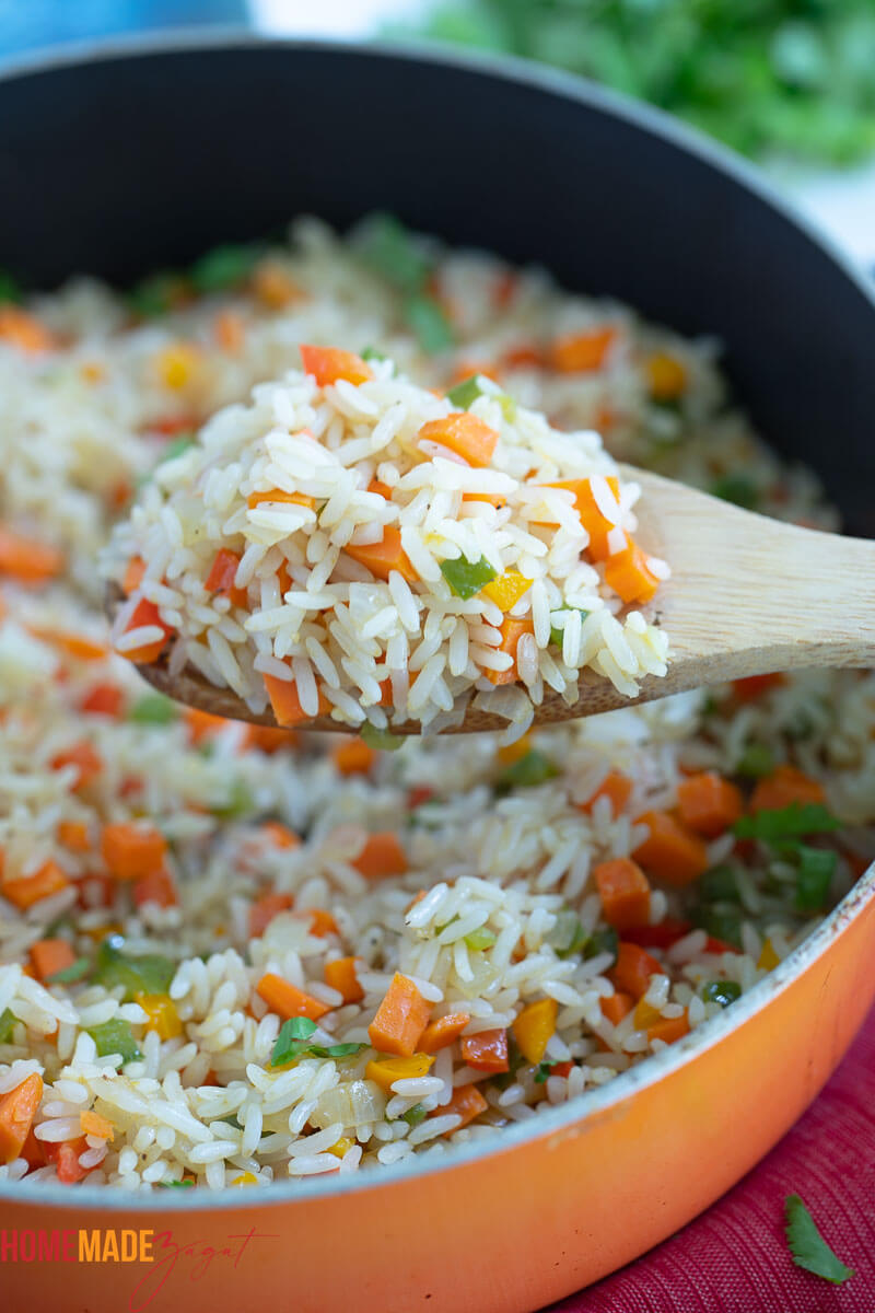 Close up of a spoon full of calypso rice