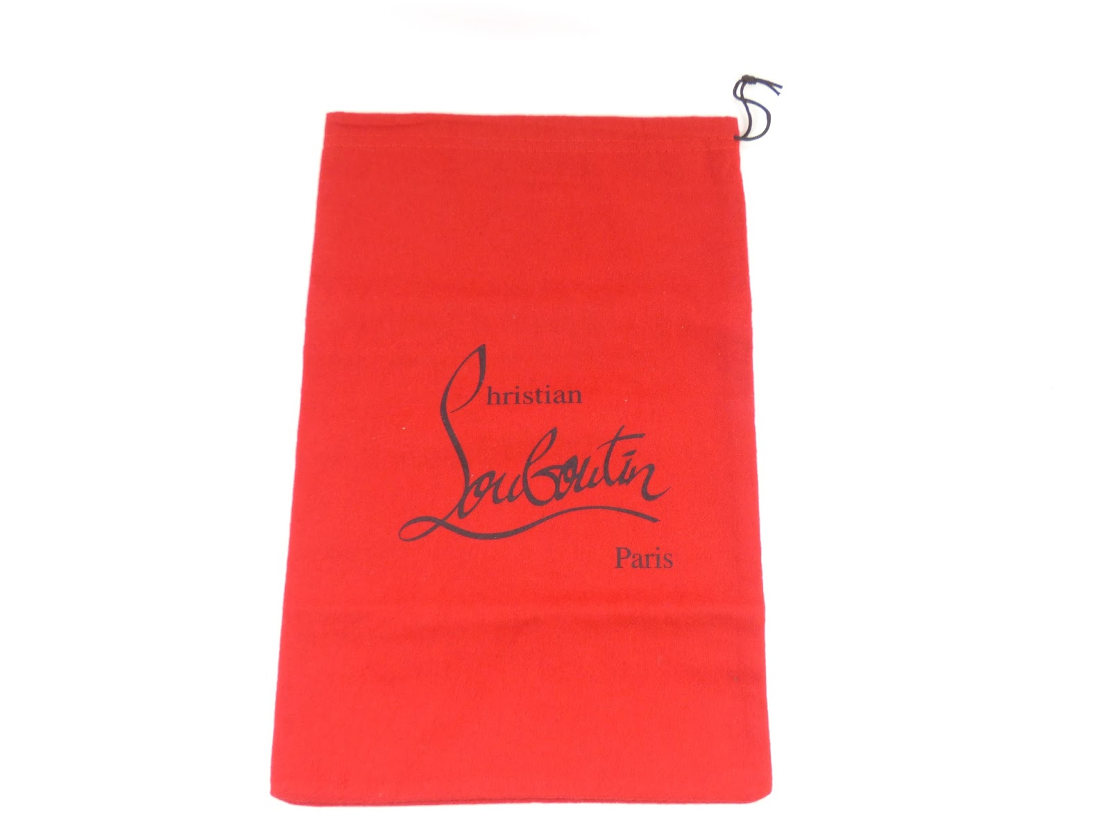 7d03151f7477 The Christian Louboutin logo should be straight and in the middle of the  dustbag and heeltip bag. Replica dustbags often have the logo slanted.