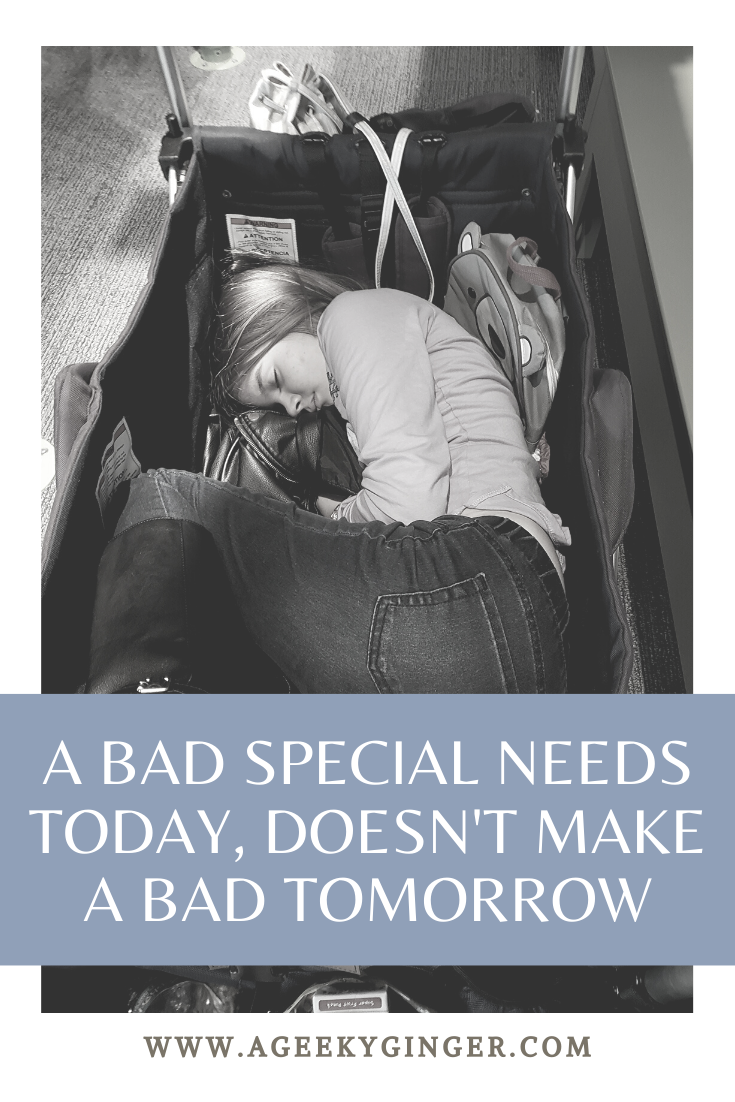 A young girl on the Autism Spectrum, laying curled up in a stroller wagon.
