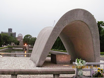 Memorial Cenotaph, with Peace Flame between it and Atomic Dome across the river, Hiroshima, Japan