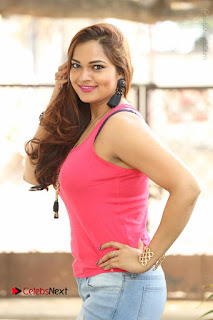 Tollywood Actress Ashwini Latest Stills in Ripped Jeans  0004.JPG