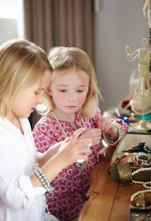 children playing with fashion jewellery