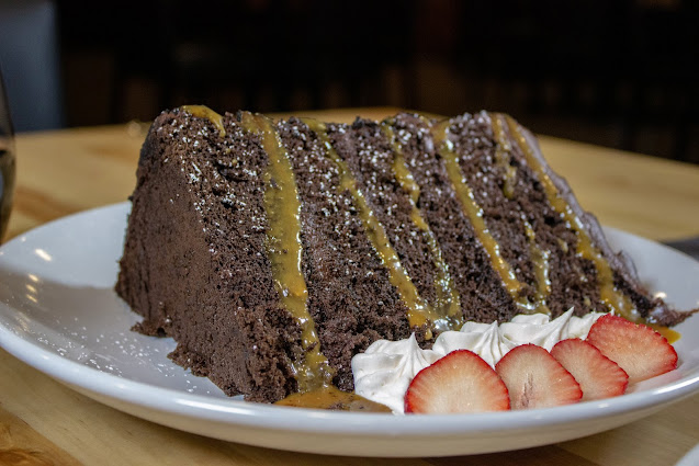 Decadent Towering Chocolate Cake from Wissota Chophouse. Image courtesy of Wissota Chophouse.