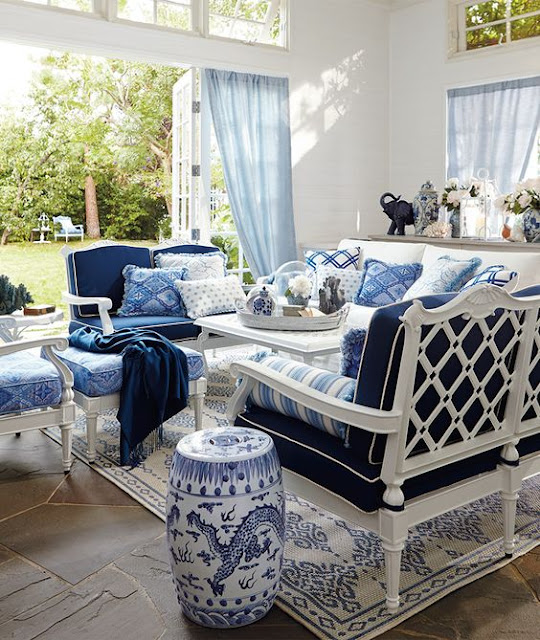 Gorgeous blue and white decorated sun room with chinoiserie stool - found on Hello Lovely Studio