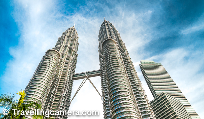 1. Petronas Twin Tower    The very first thing which comes to our minds when it's about Malaysia is Petronas Twin Towers and one can't miss this place if in Kuala Lumpur. And in such lists of top 10 things to do, visit or experience, most of the times top 3-4 places are the ones which are known to the world and such places are associated with the city or country and can't be missed. Like Taj Mahal, Statue of Liberty, Eiffel Tower etc. Anyone can tell where these places are and can't be missed when you in that land.     Petronas Twin Towers look awesome in the evening when it's very well lit. I didn't have that option as I had to leave before these lights are switched on. But whenever you plan, try planning to visit Twin-towers in late evening. I am sure you must have seen those beautiful night photographs of Petronas Twin Towers on various other websites/blogs.     There is an interesting history behind how these towers evolved. Instead of translating everything here, I would encourage to check this link to know when the planning of the towers started, how it proceeded etc.