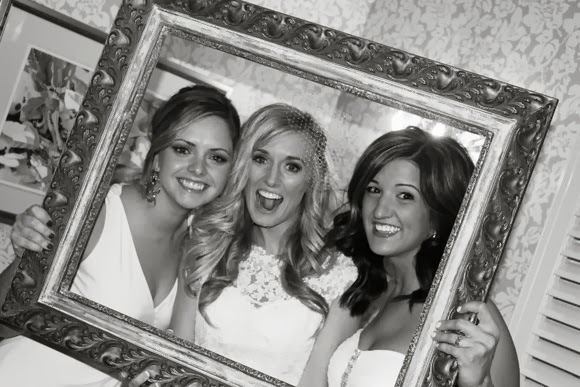 The bride and her friends make funny faces in this black and white picture