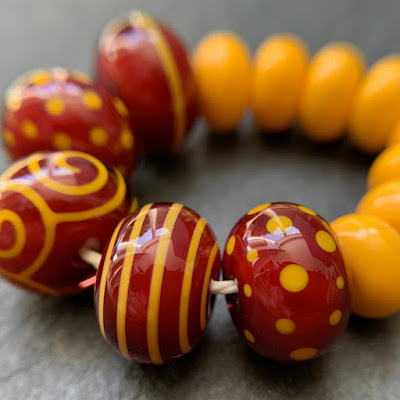 Handmade lampwork glass 'Gryffindor' beads by Laura Sparling