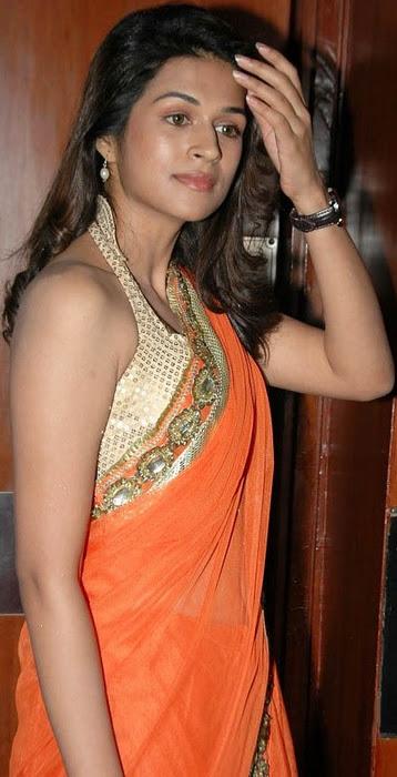 Shraddha Das Navel Show Photos In Orange Saree