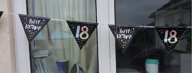 18th birthday banners up at the window