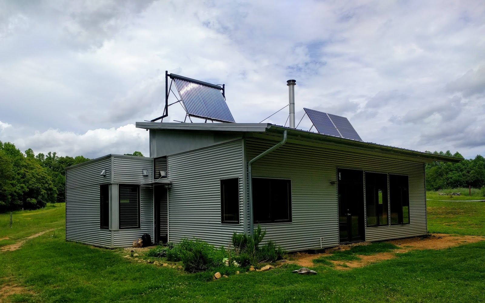 Off Grid Passive Solar Prefab House In Summer And A Lovely