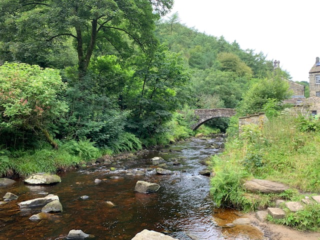Stream and bridge at Hardcastle Crags, with the mill in the background