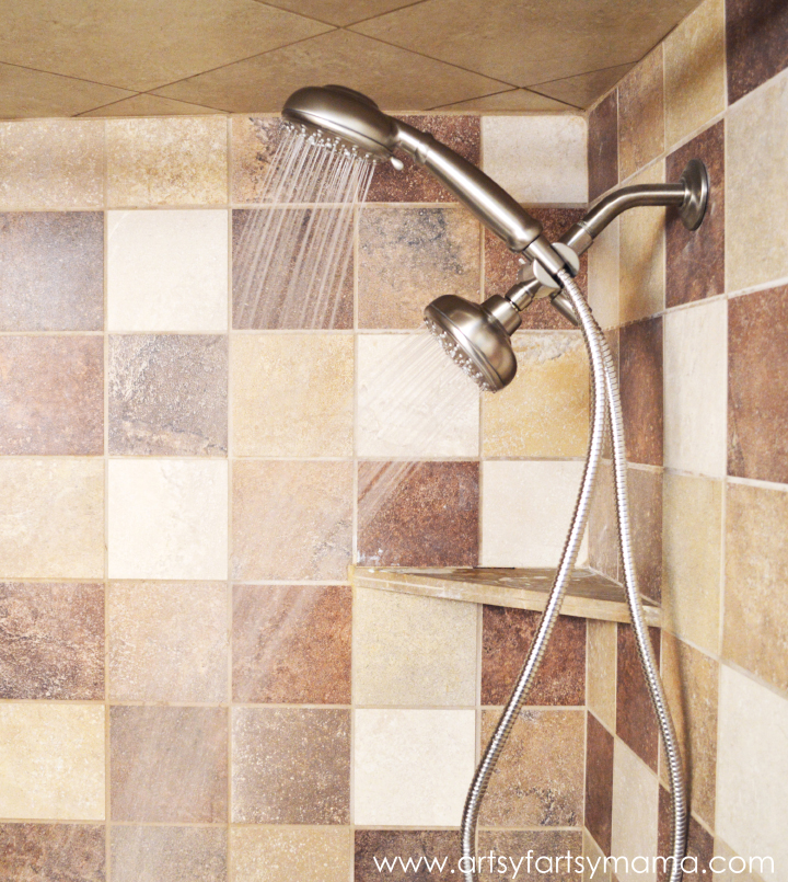 How to Replace a Shower Head at artsyfartsymama.com #DIY #bathroom #shower #Moen