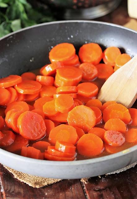Honey Glazed Carrots in Saucepan Image