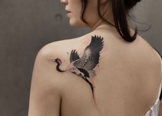 What is the meaning of the crane tattoo pattern?