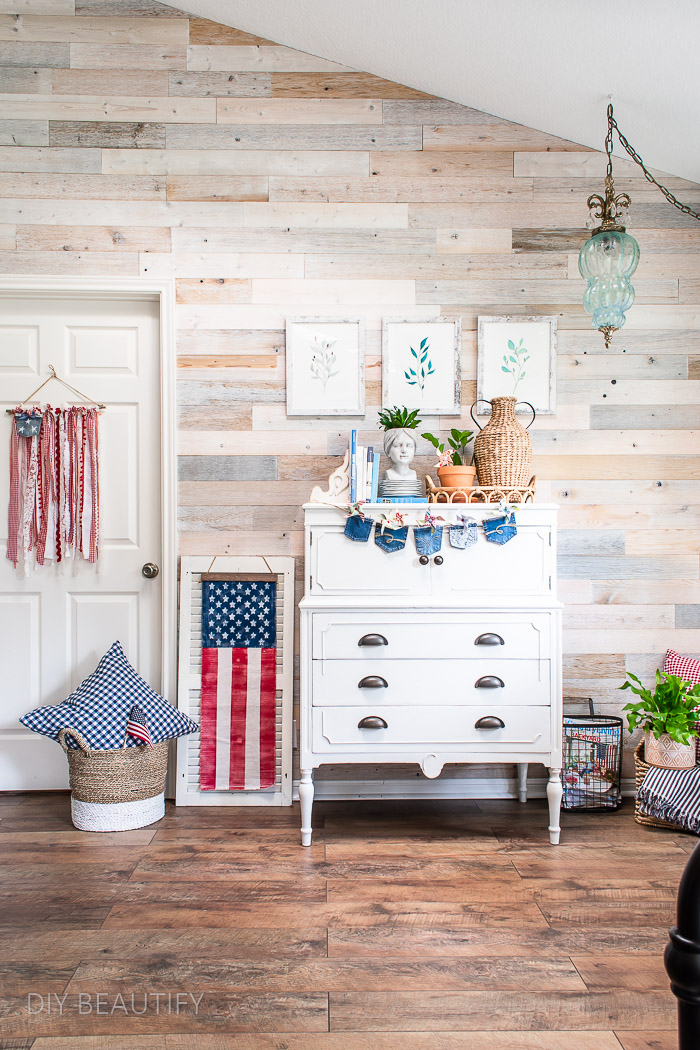 wood wall with cottage dresser and vintage patriotic flag decor