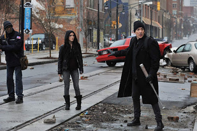 "Samuel L. Jackson, Isabelle Fuhrman, and John Cusack scouer New England to find survivors of a deadly cell phone plague in a movie still for the 2016 film ""Cell"""