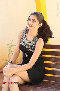 Actress Poojitha Pallavi Naidu Stills in Black Short Dress at Inkenti Nuvve Cheppu Movie Platinum Disc Function  0176.JPG