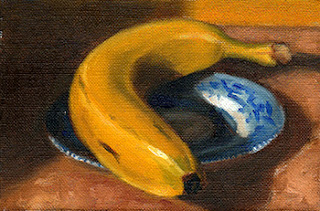 Oil painting of a banana on a blue and white porcelain saucer.