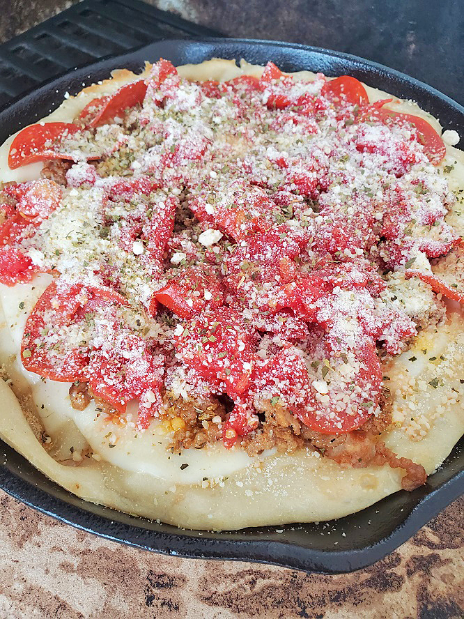 this is original deep dish Chicago style pizza made on the grill in a cast iron skillets