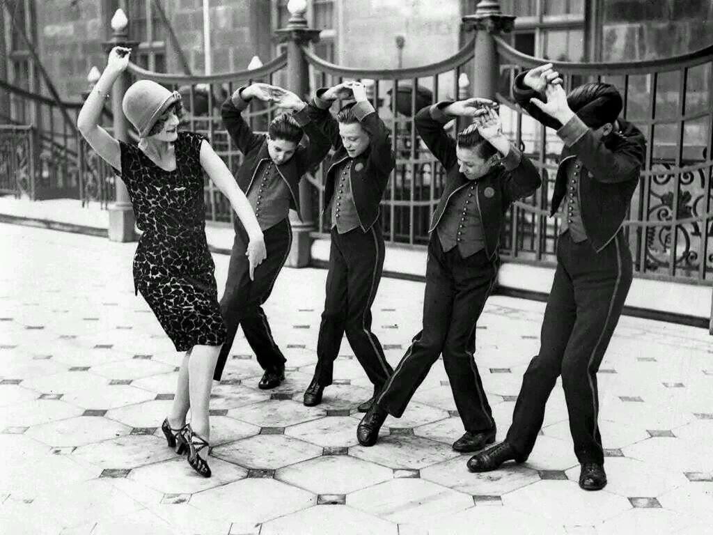 American Woman Teaching English Boys To Dance The
