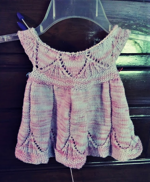 An infant dress knit with Stroll Tonal washable fingering weight wool. https://shareasale.com/r.cfm?b=1435425&u=1446317&m=59159&urllink=&afftrack=