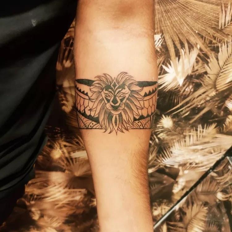 Lion design armband tattoo.