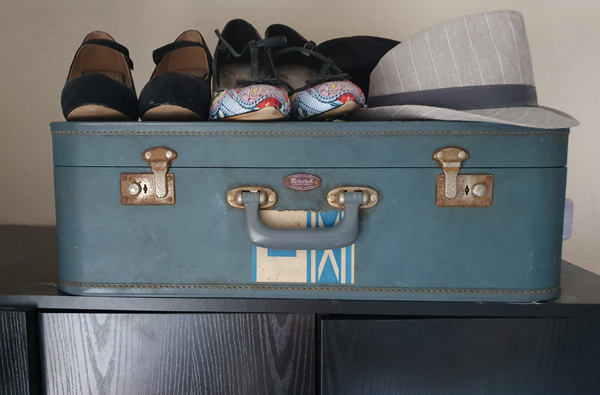suitcase on top of wardrobe