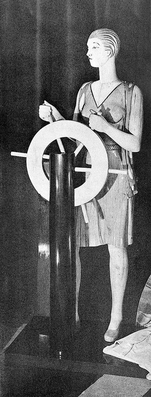 a 1927 mannequin at a ships wheel