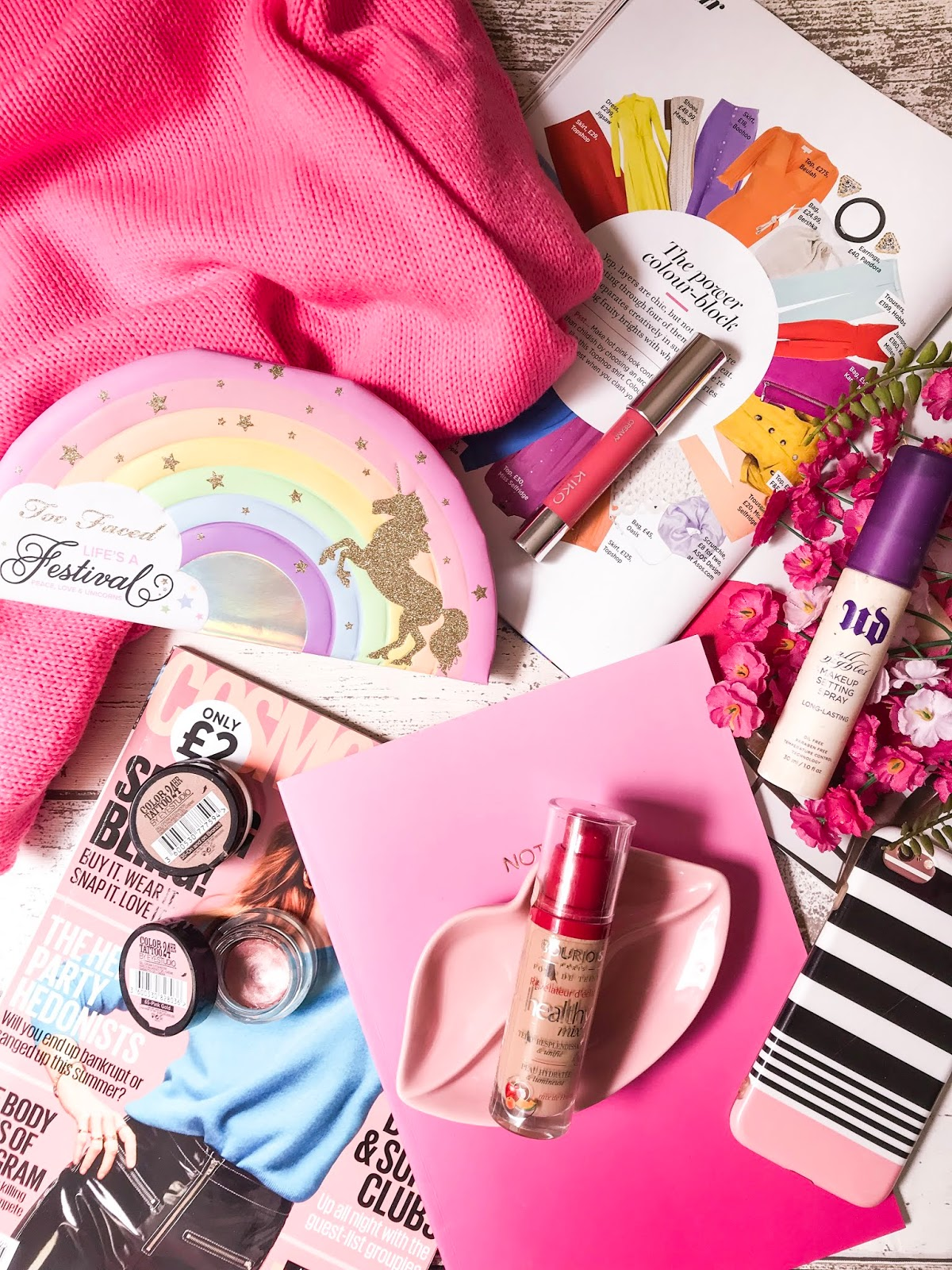 summer makeup flatlay with makeup products