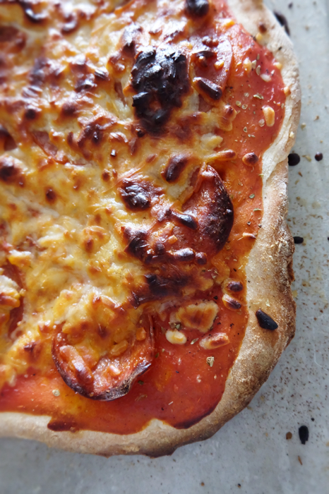 close up of baked pizza edge