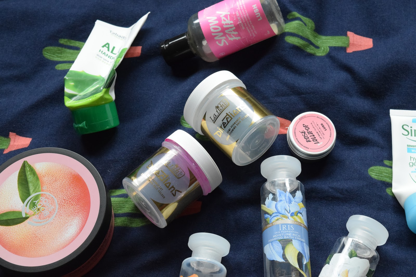 flatlay of empty beauty products including lariche directions, Lush and The Body Shop