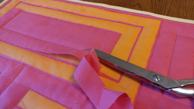 Cutting away fabric layers for reverse applique