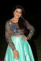 Nikki Galrani in Green Skirt  Top at Marakathamani music launch ~  Exclusive (135).JPG