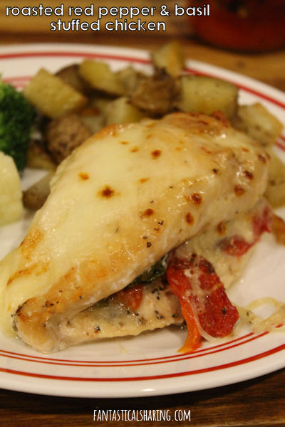 Roasted Red Pepper & Basil Stuffed Chicken // Make a fancy meal with this easy stuffed chicken recipe - the sweet roasted pepper is the perfect match for basil and mozzarella cheese #maindish #recipe #chicken