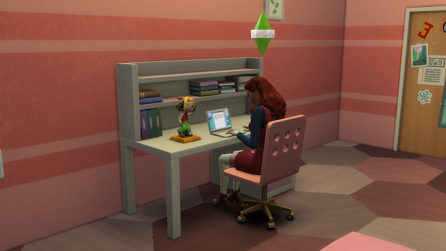 Screen grab of a sim at a desk on a laptop in sims 4