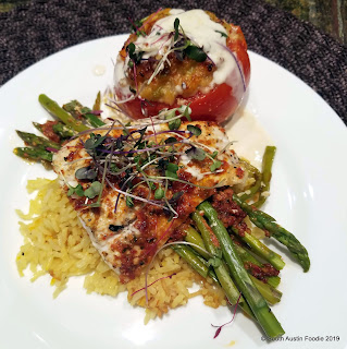 Stuffed tomatoes, sundried tomato pesto, halibut, asparagus, saffron rice